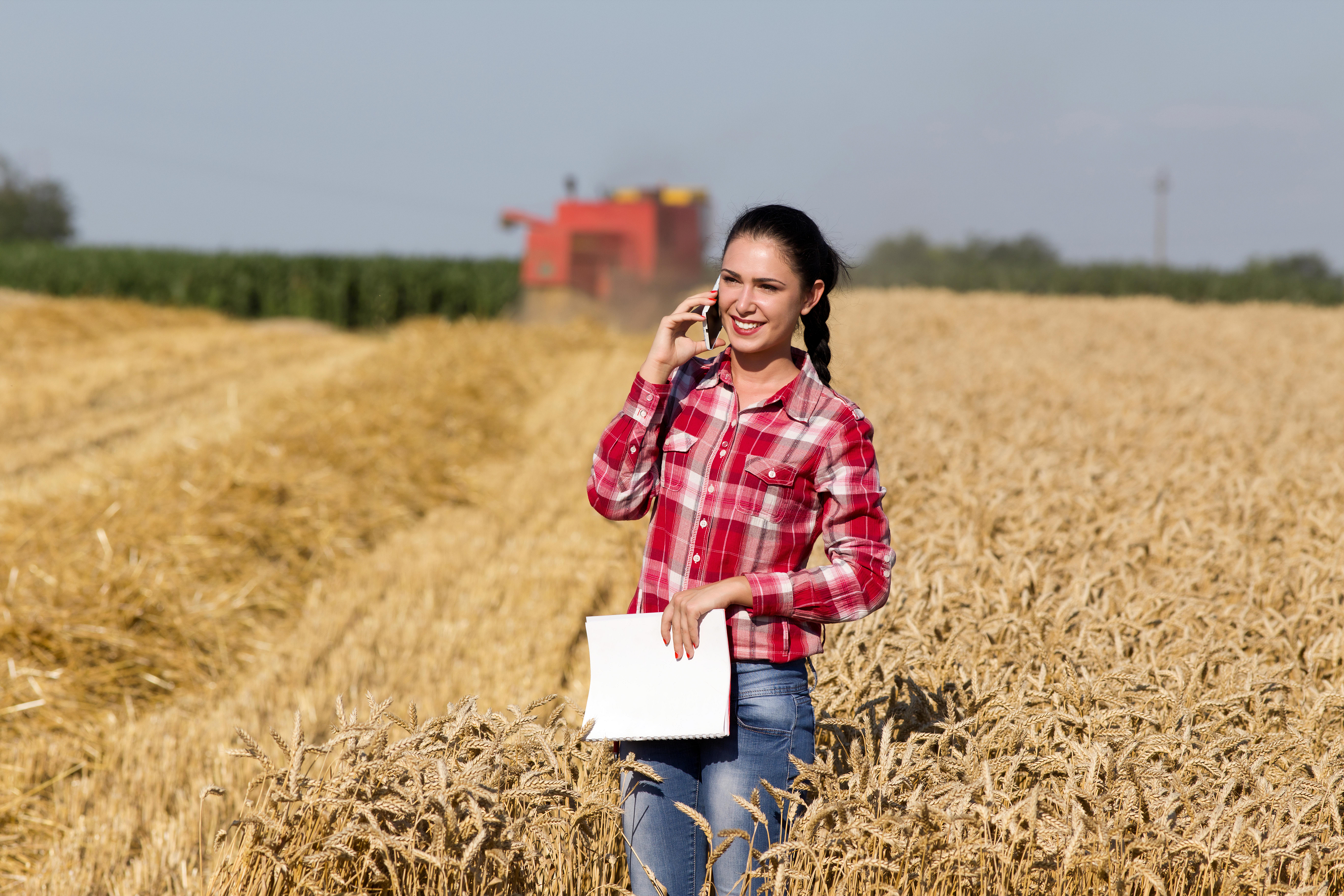 Farmer on the phone in a field
